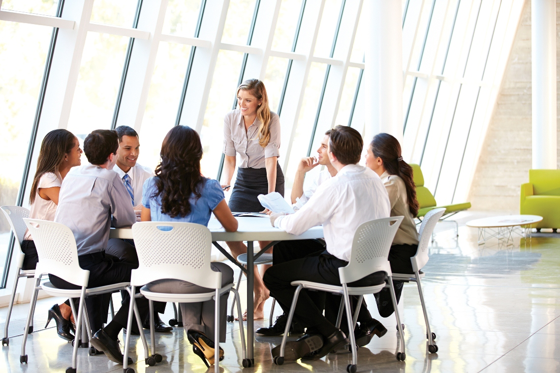 Group of people holding a meeting in an office space