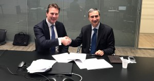 IDS and Technogenetics leaders shaking hands as they finalise an agreement